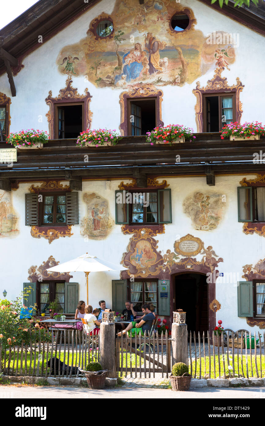 Religious painting on Beim Kirchenbauer pension and wine estate in village of Oberammergau in Upper Bavaria, Germany Stock Photo