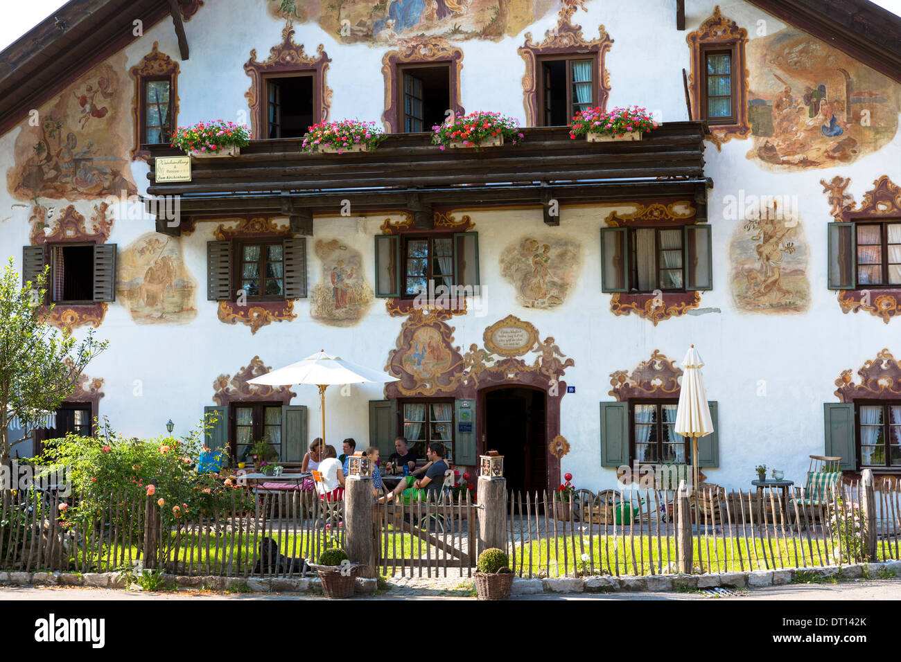 Religious painting on Beim Kirchenbauer pension and wine estate in village of Oberammergau in Upper Bavaria, Germany - Stock Image