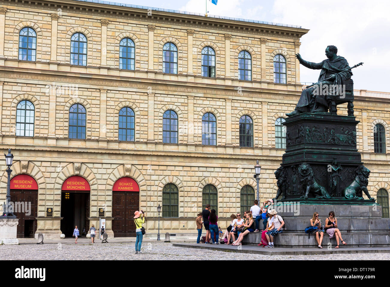 Tourist photographs statue of Maximillian Iosepho, King of Bavaria by the Residenz in Munich, Bavaria, Germany - Stock Image