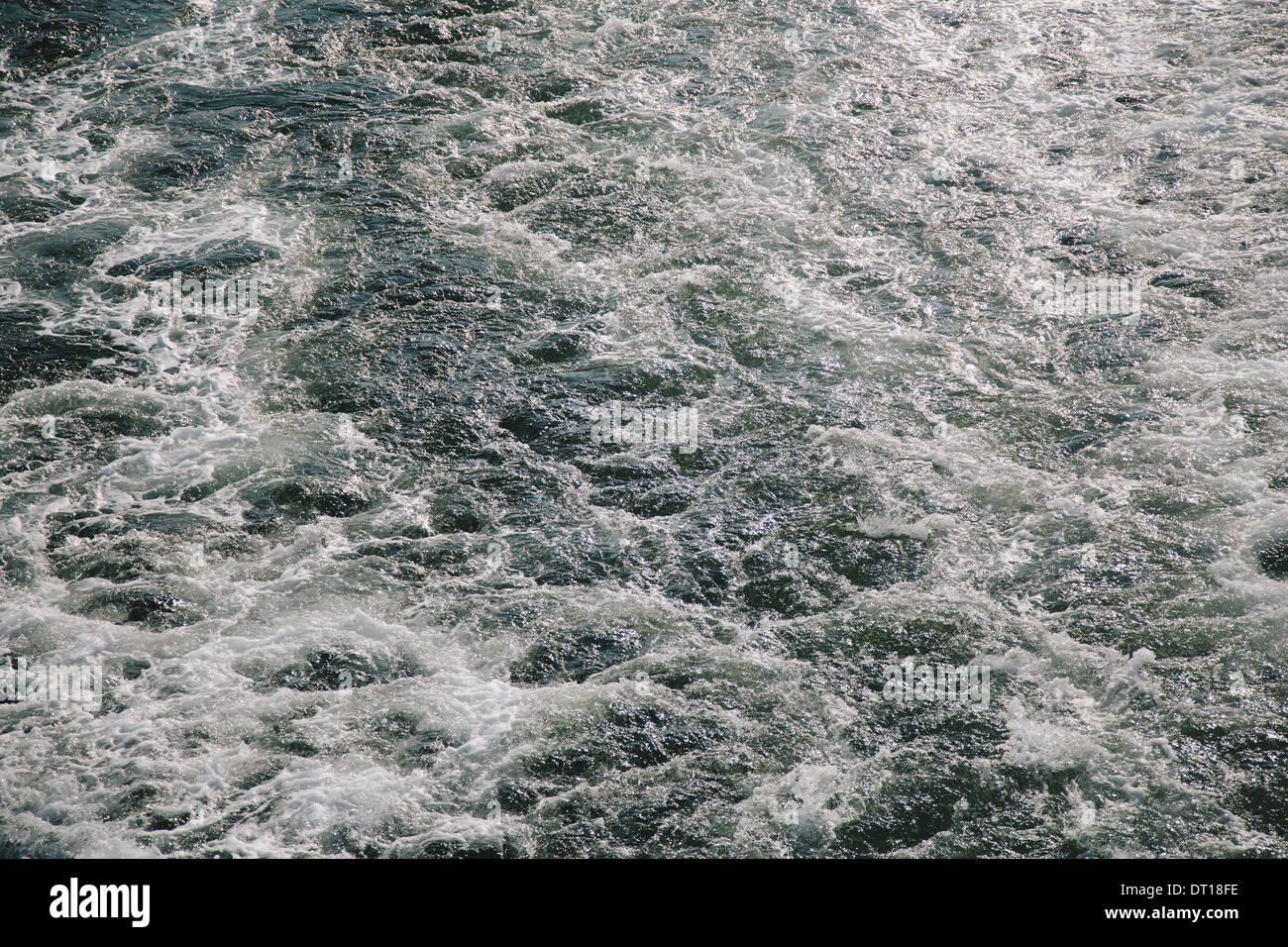 Seattle Washington USA Wake from passenger ferry on water near Seattle - Stock Image