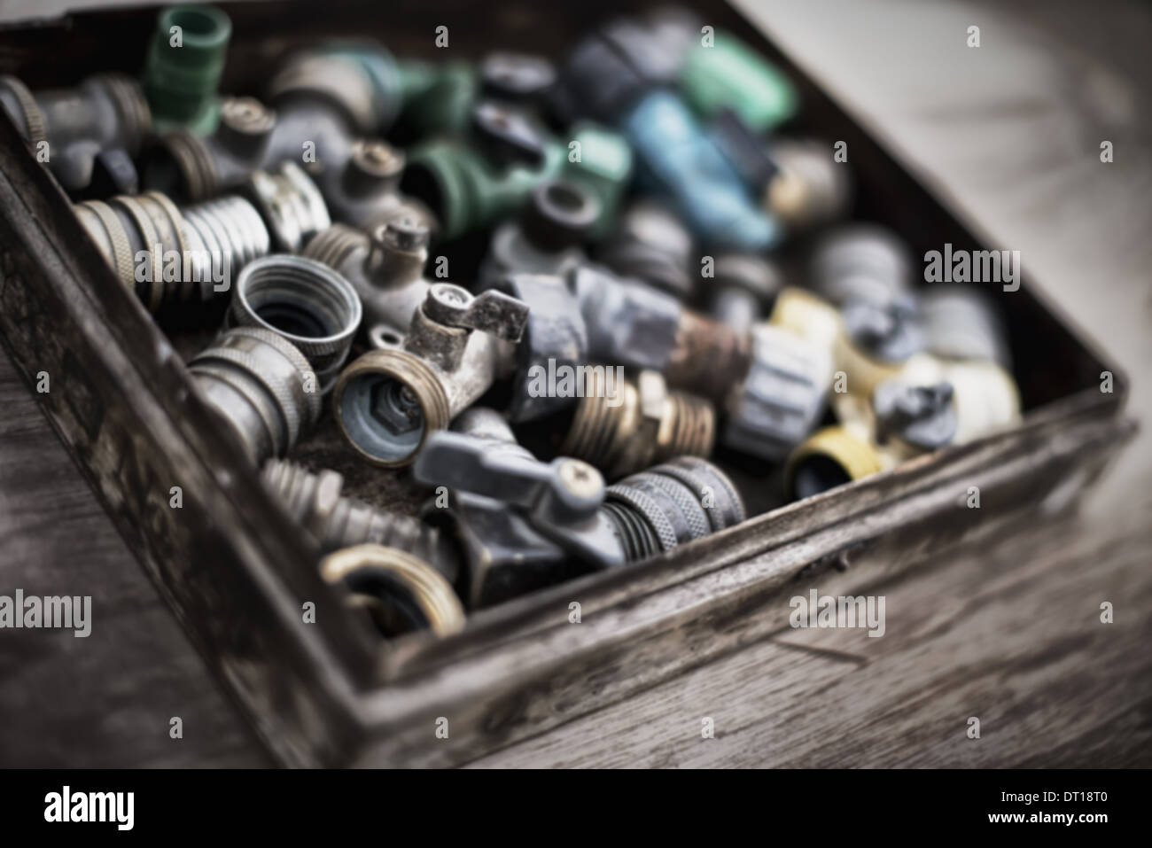 Woodstock New York USA Washers and hose pipe joint fittings in wooden box - Stock Image