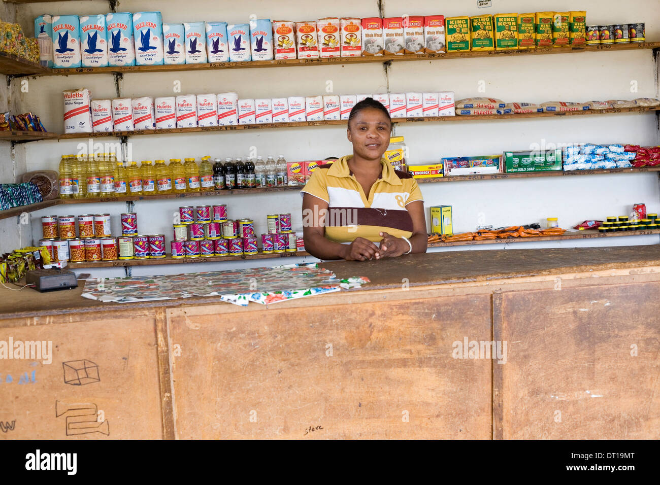 Small scale business women in her small rural (spaza) shop