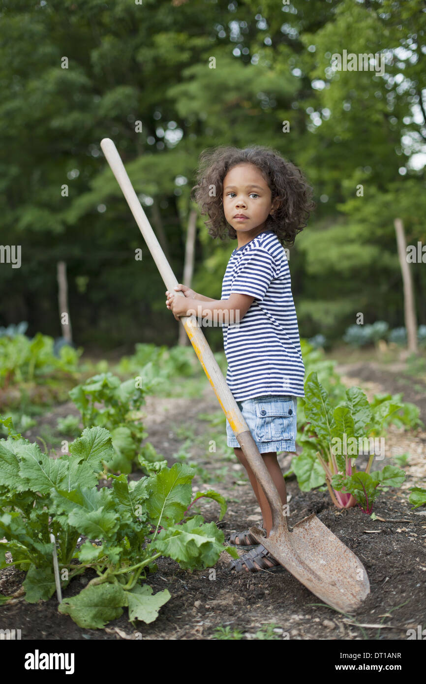 Woodstock New York USA African American boy holding long handled space - Stock Image