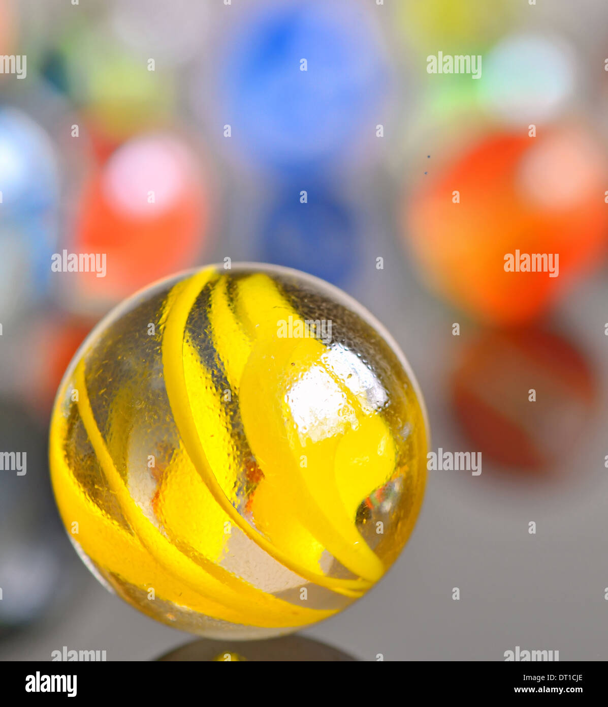 yellow glas ball isolated - Stock Image