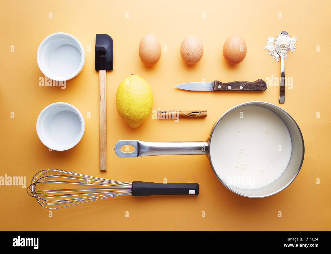 Creme brulee ingredients on yellow background unusual presentation - Stock Image