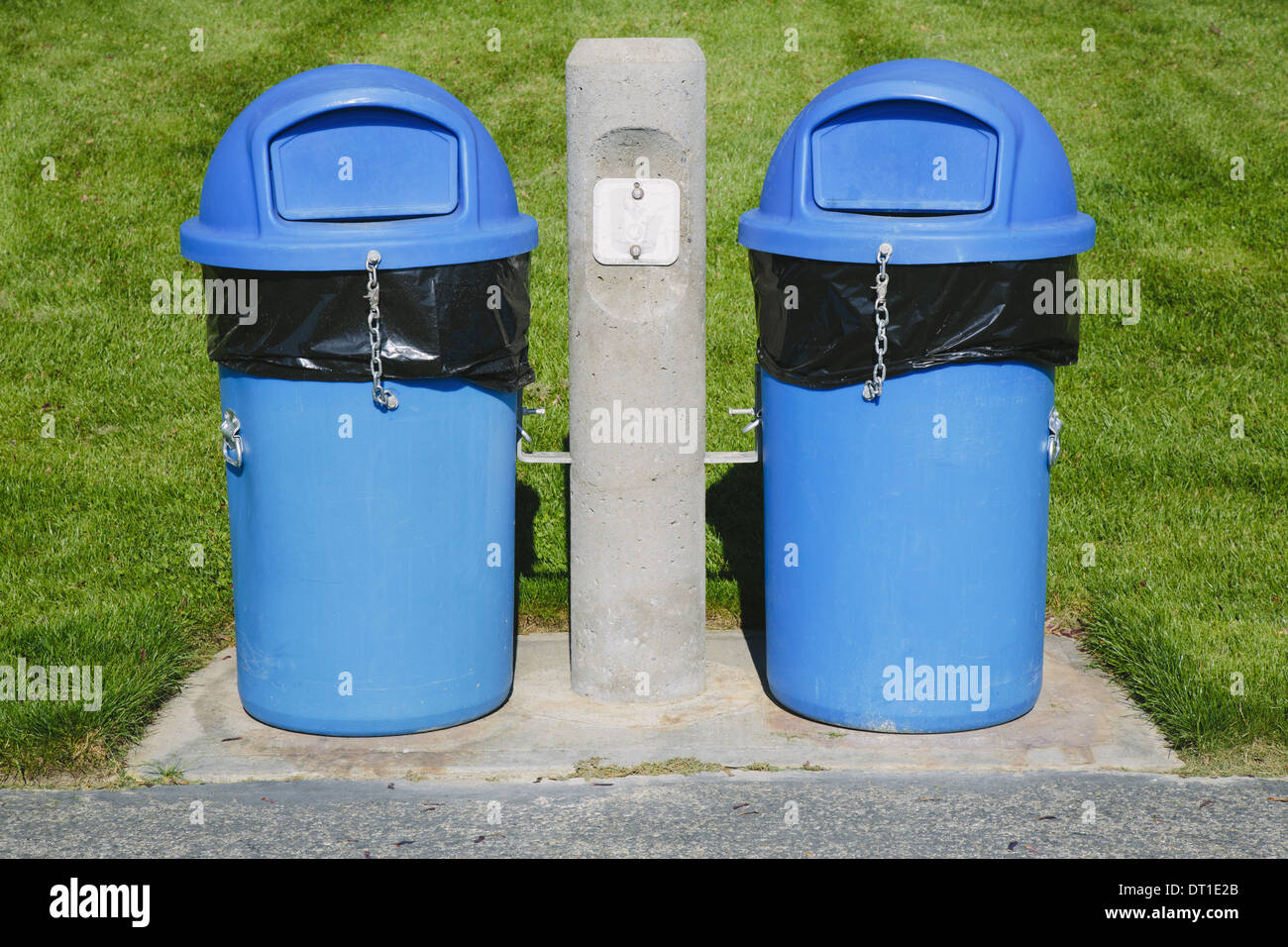 Washington State USA Blue trash cans on grass sports field - Stock Image