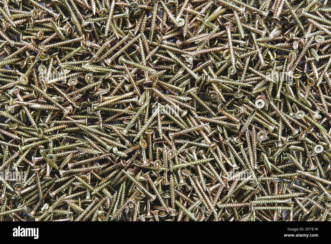 pile of brass screws with screw thread - Stock Image