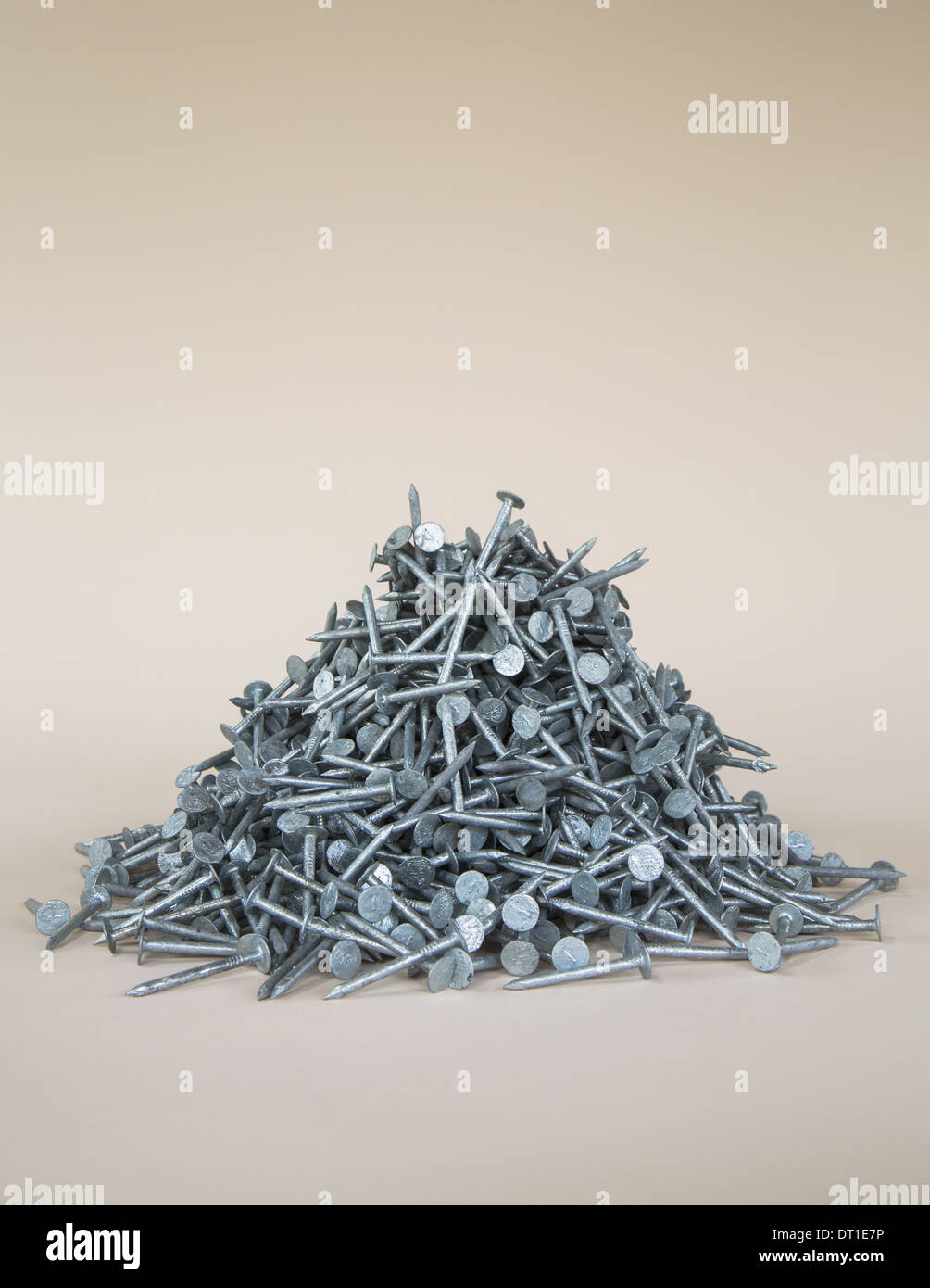 heaped pile of galvanized nails - Stock Image