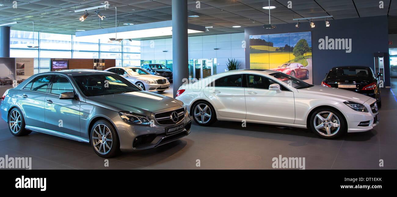 Mercedes-AMG E63 AMG Saloon V8 biturbo (left) and Mercedes C350 AMG Sport (right) in Mercedes-AMG showroom in Stuttgart, Stock Photo