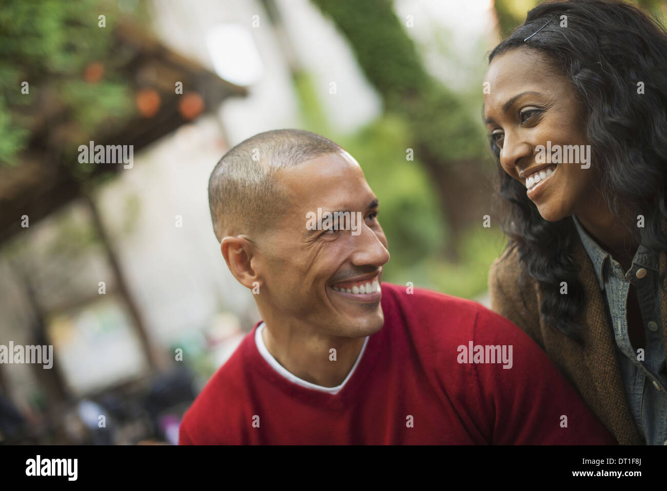 Scenes from urban life in New York City A man and a woman a couple Looking at each other Outdoors - Stock Image