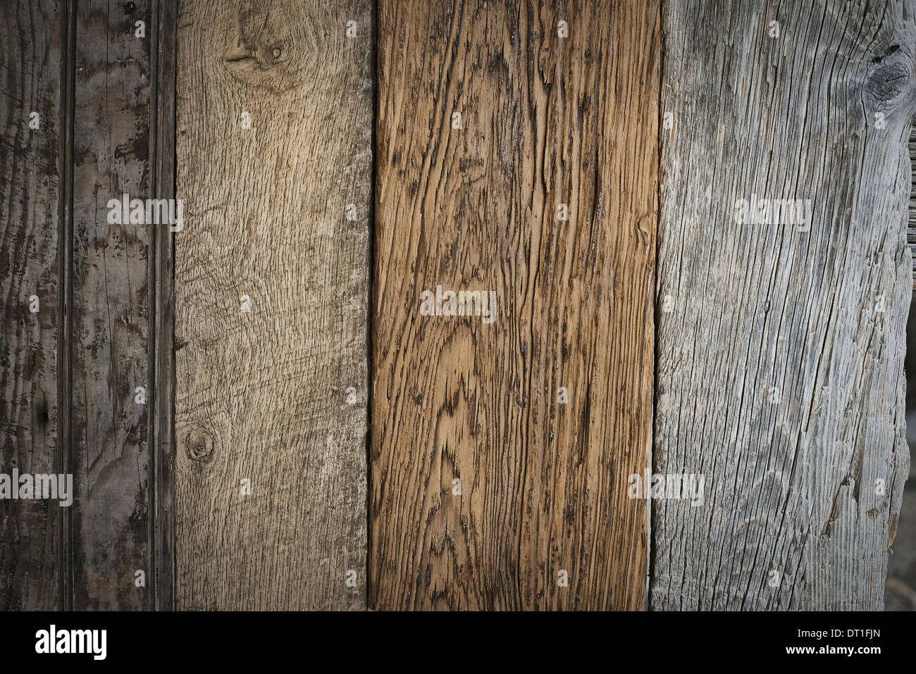A heap of recycled reclaimed timber planks of wood Environmentally responsible Varieties of wood with grain and colour details - Stock Image