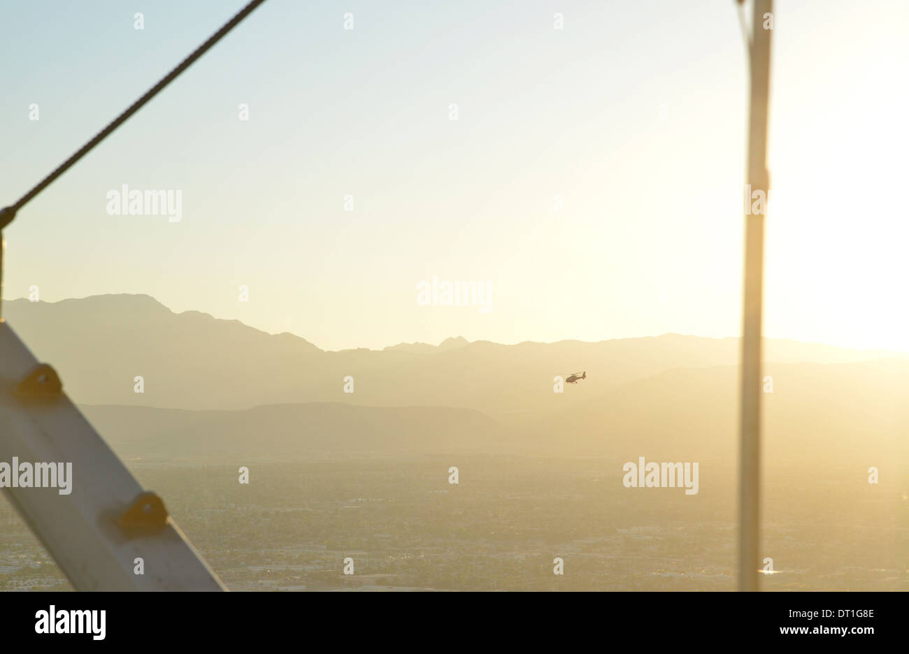 Tourist helicopters return to Las Vegas from the Grand Canyon at dusk, seen from the Stratosphere hotel - Stock Image