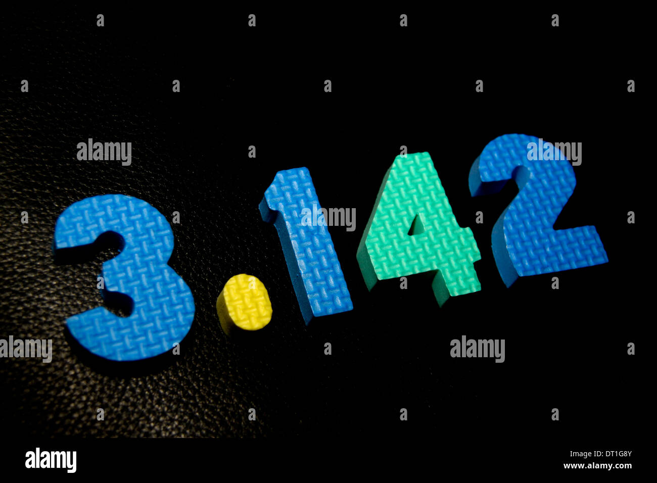 Value of Pi 3.142 in plastic cutout coloured numbers - Stock Image