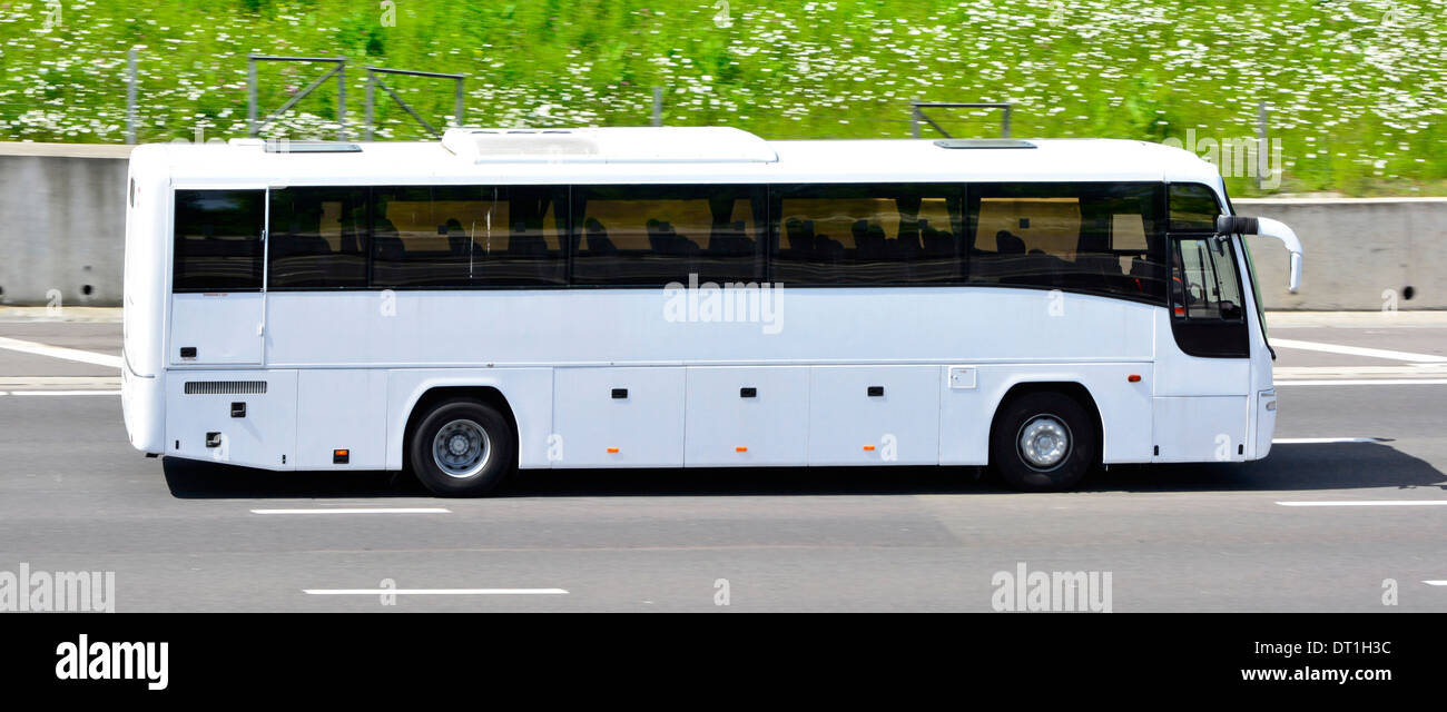 White unmarked clean coach no advertising driving along M25 motorway