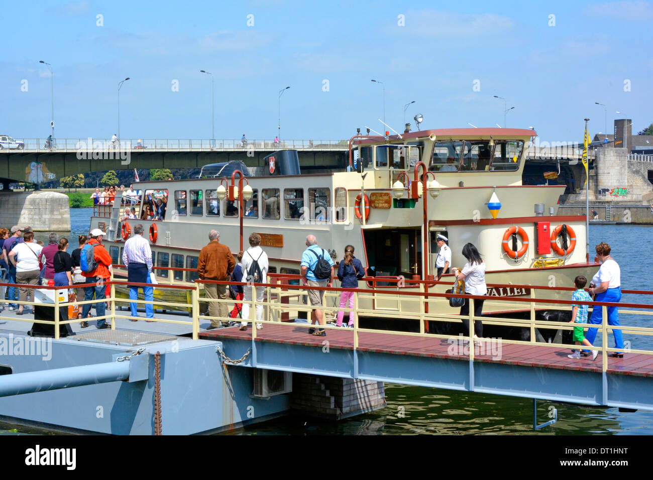 River Meuse tour boat returning to Maastricht with next group of passengers waiting to board - Stock Image