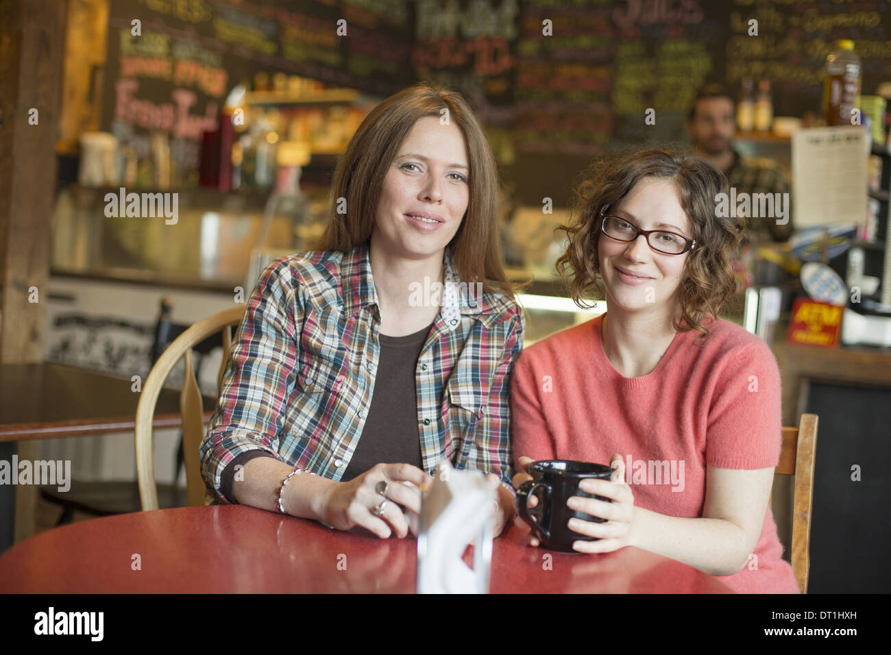 A coffee shop and cafe in High Falls called The Last Bite Two women sitting at a table - Stock Image