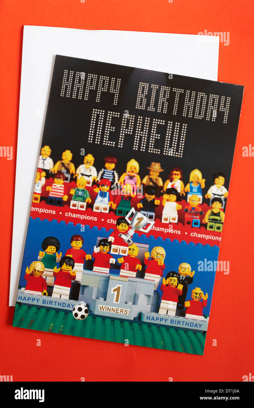 Happy Birthday Nephew lego birthday card from Marks & Spencer with envelope isolated on red background Stock Photo