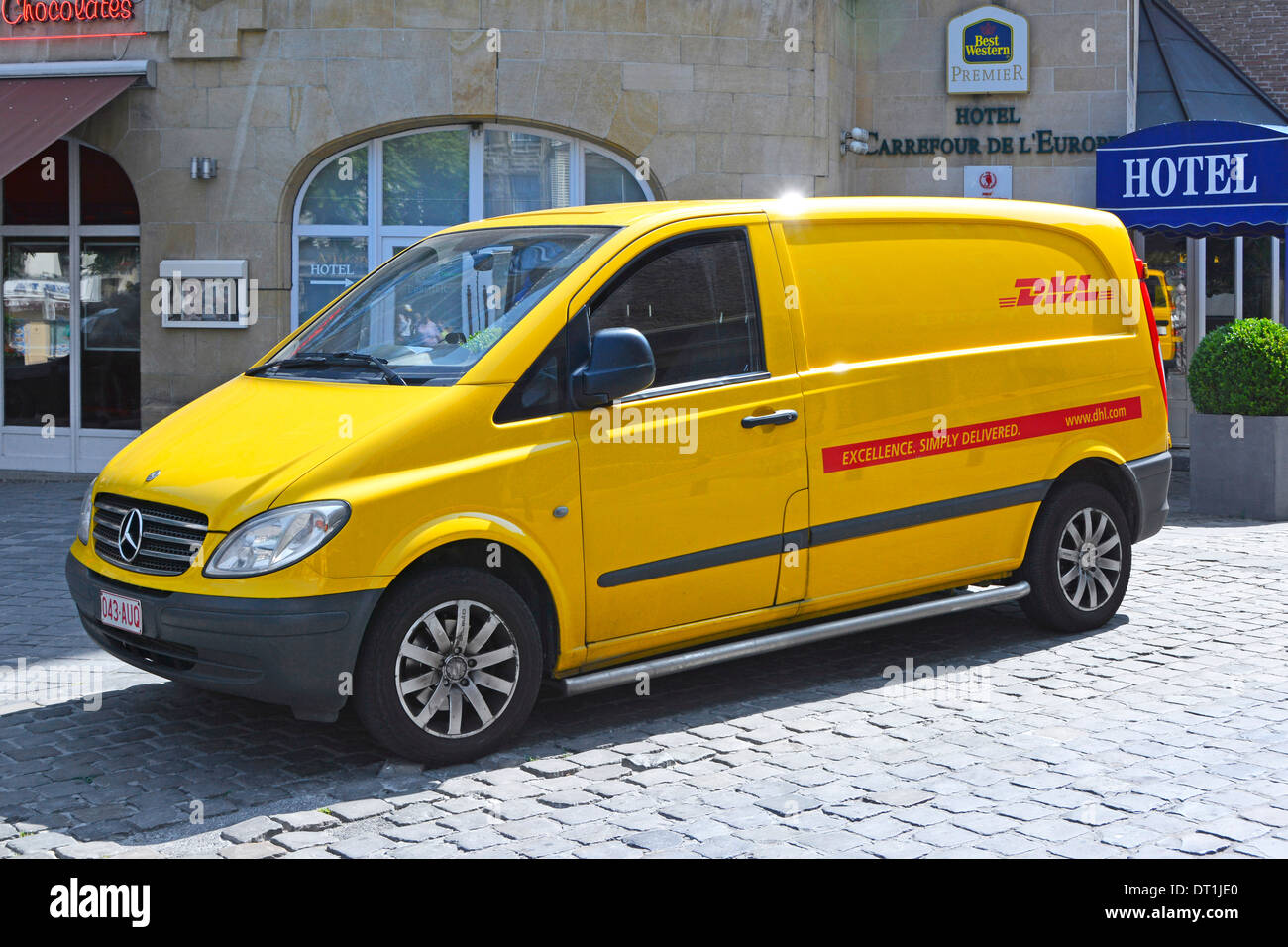 5bb45ae0d25f1b Yellow DHL Mercedes Benz delivery van parked up outside Best Western ...