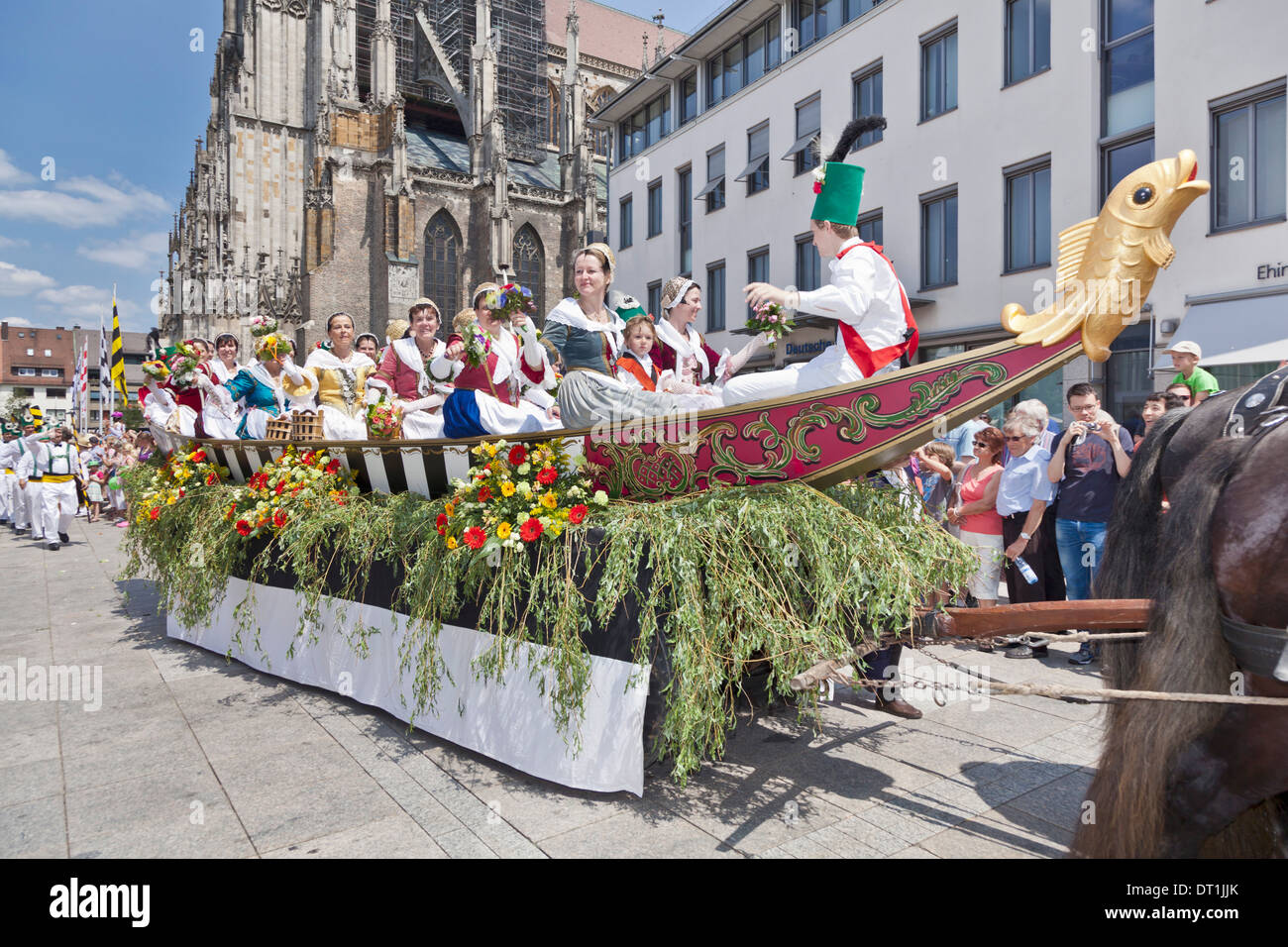 Fisher women on a boat in costumes at the Munsterplatz square, Fischerstechen, Ulm, Baden Wurttemberg, Germany - Stock Image
