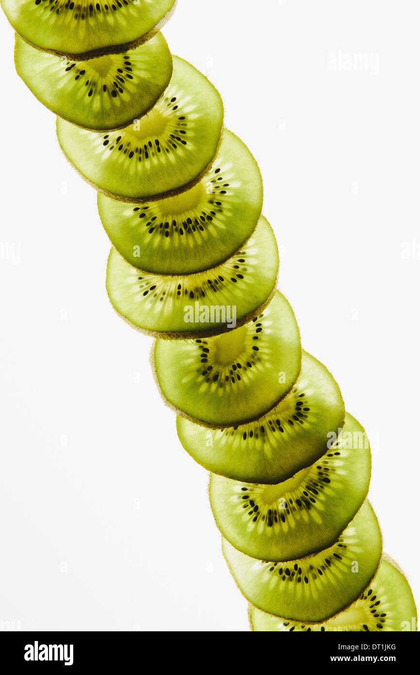 Organic kiwi slices white background - Stock Image