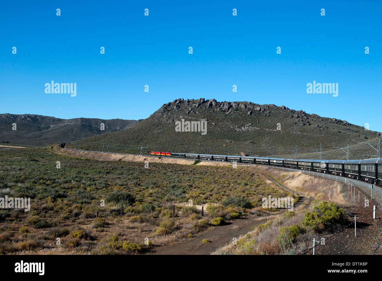 Rovos Rail train about to enter a tunnel in the Klein Karoo desert, South Africa, Africa - Stock Image