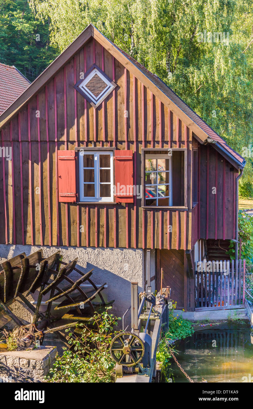 water wheel in front of a building of the so-called _schuettesaege-museum_, a museum dedicated to historic rafting and woodwork - Stock Image