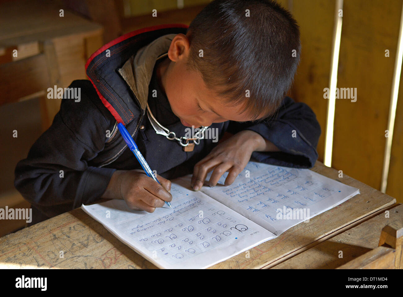 Black Hmong ethnic group boy at school, Sapa area, Vietnam, Indochina, Southeast Asia, Asia - Stock Image