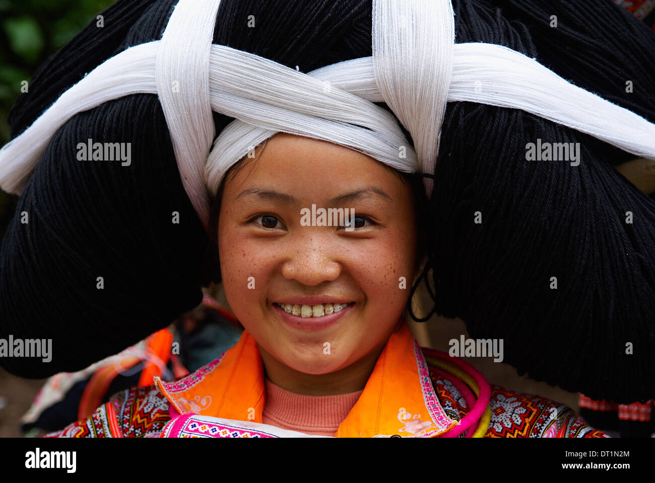 Long Horn Miao girls in traditional costumes celebrating Flower Dance Festival, Longjia village, Guizhou Province, China, Asia - Stock Image