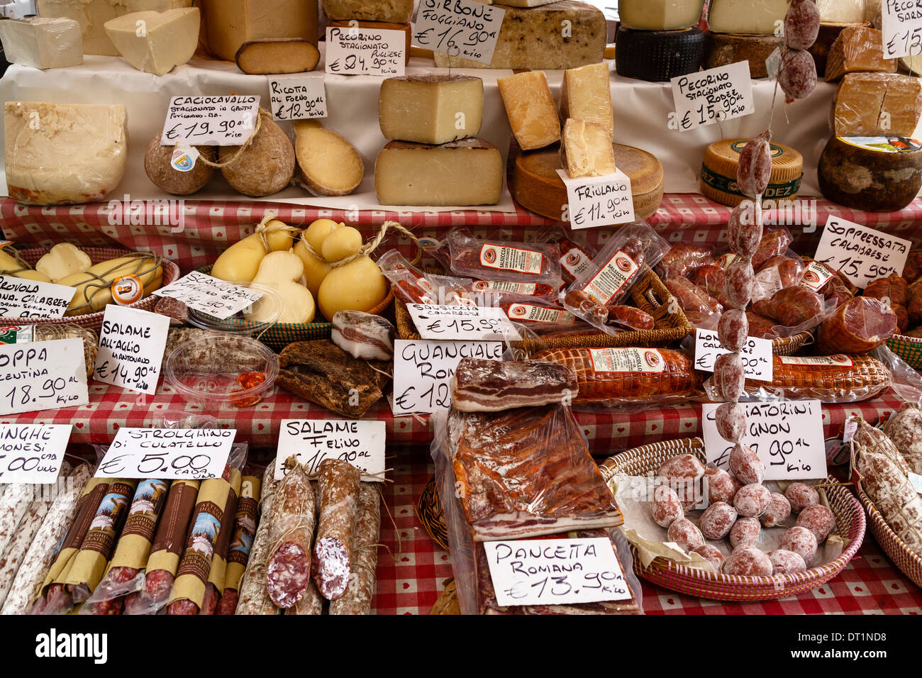 Cheese and salamis at Papiniano market, Milan, Lombardy, Italy, Europe - Stock Image