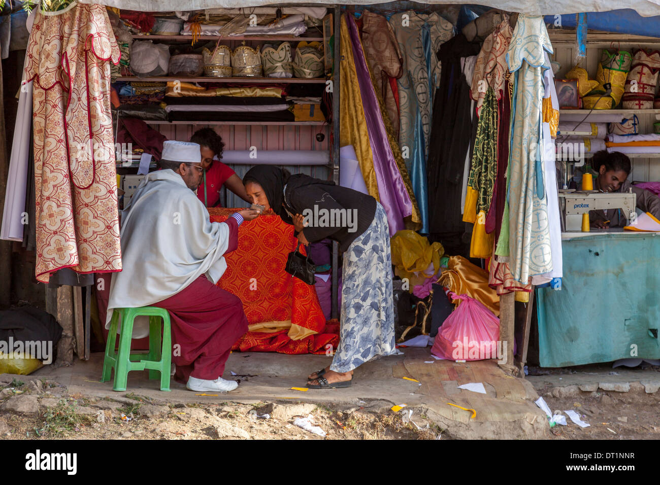 Street Scene, A Priest Blesses A Young Woman, Addis Ababa, Ethiopia - Stock Image
