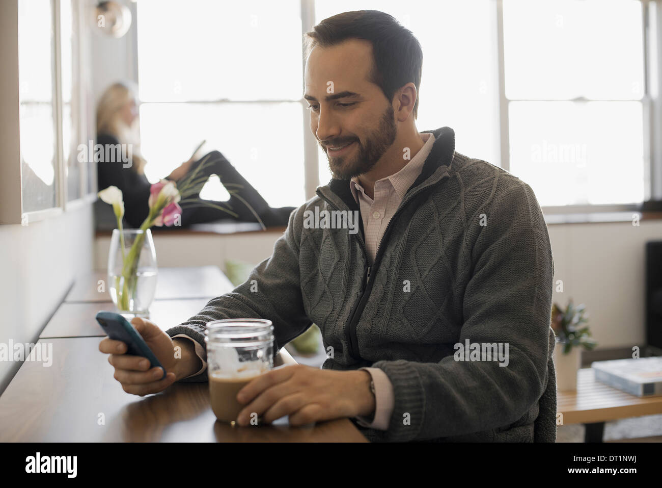 Couple Relaxing at Home with Laptop and E-Reader - Stock Image