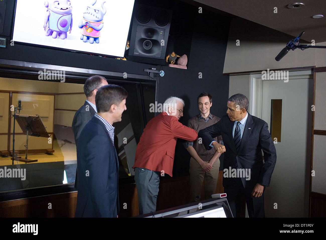 US President Barack Obama elbow bumps comedian Steve Martin during a tour of the Glendale campus of movie studio DreamWorks Animation SKG November 25, 2013 in Glendale, CA. - Stock Image