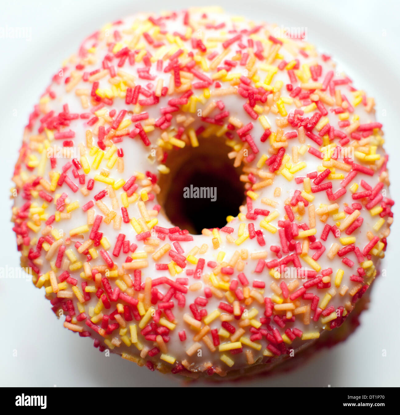 White iced ring donut, London - Stock Image