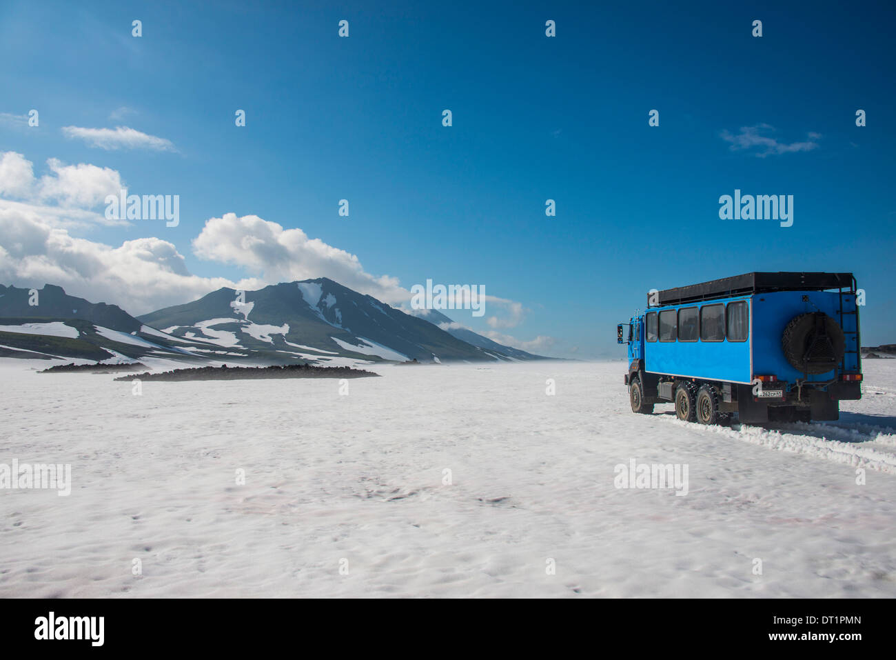Russian truck crossing a snowfield, Mutnovsky volcano, Kamchatka, Russia, Eurasia - Stock Image