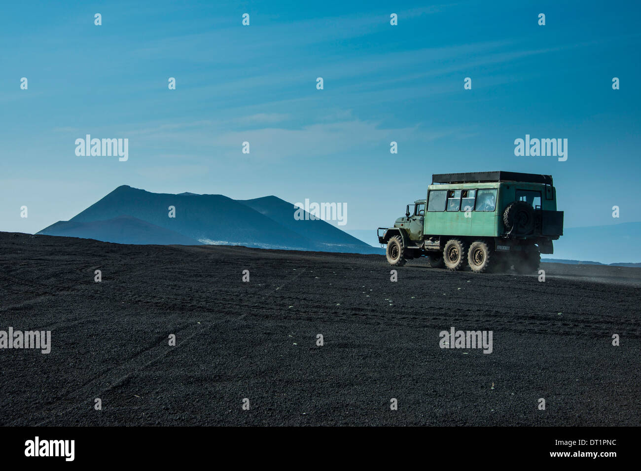 Russian truck drives through the lava sand field of the Tolbachik volcano, Kamchatka, Russia, Eurasia - Stock Image