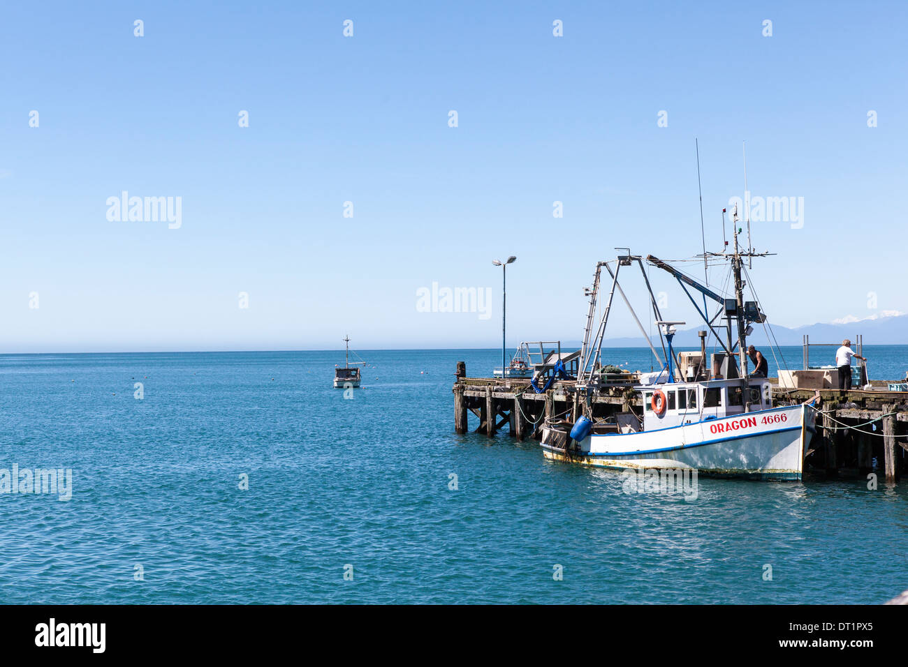 fisher boat in Oragon, New Zealand - Stock Image