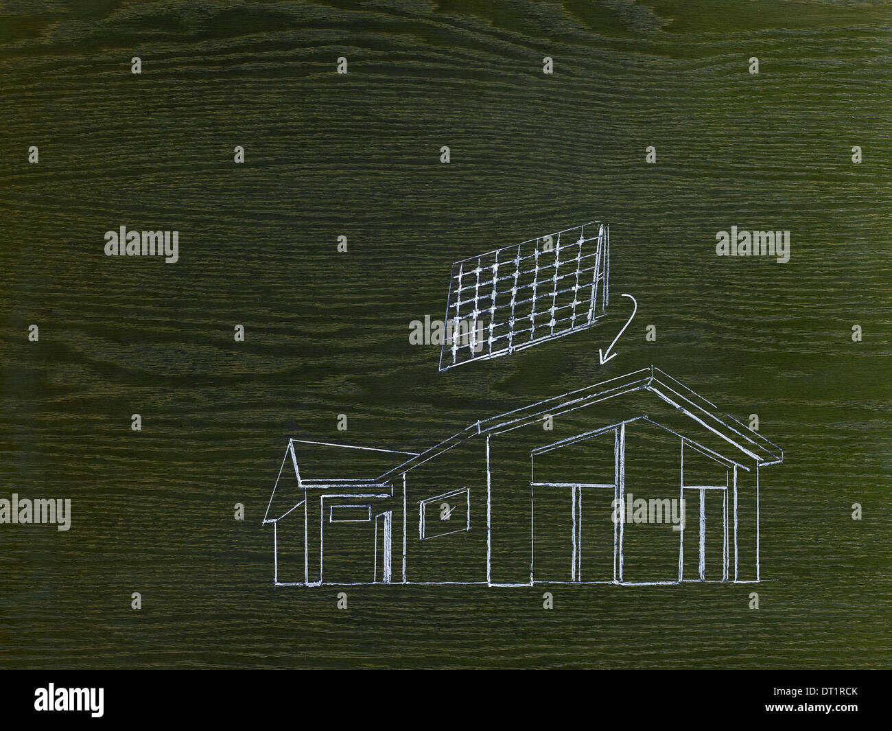 A line drawing image on grained wood A green building project a house with solar panels for the roof - Stock Image
