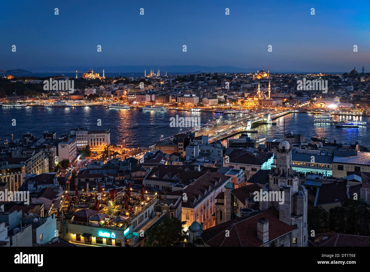 View over the Golden Horn with the Galata bridge. In the distance the Aya Sofya and the Blue Mosque mark the skyline. - Stock Image