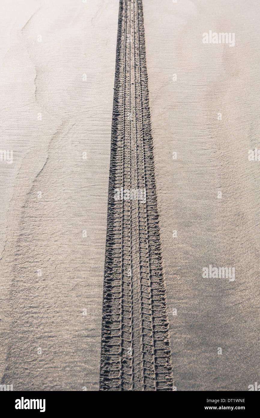 Tire tracks on beach Ocean Park - Stock Image