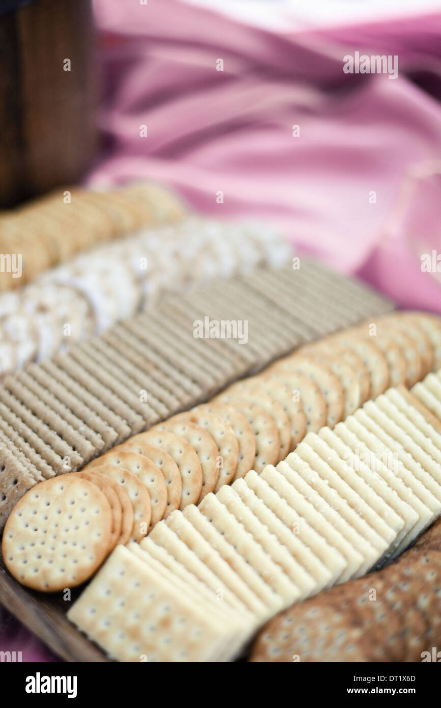 A tray of cheese crackers and biscuits laid out A choice of shapes and flavours - Stock Image