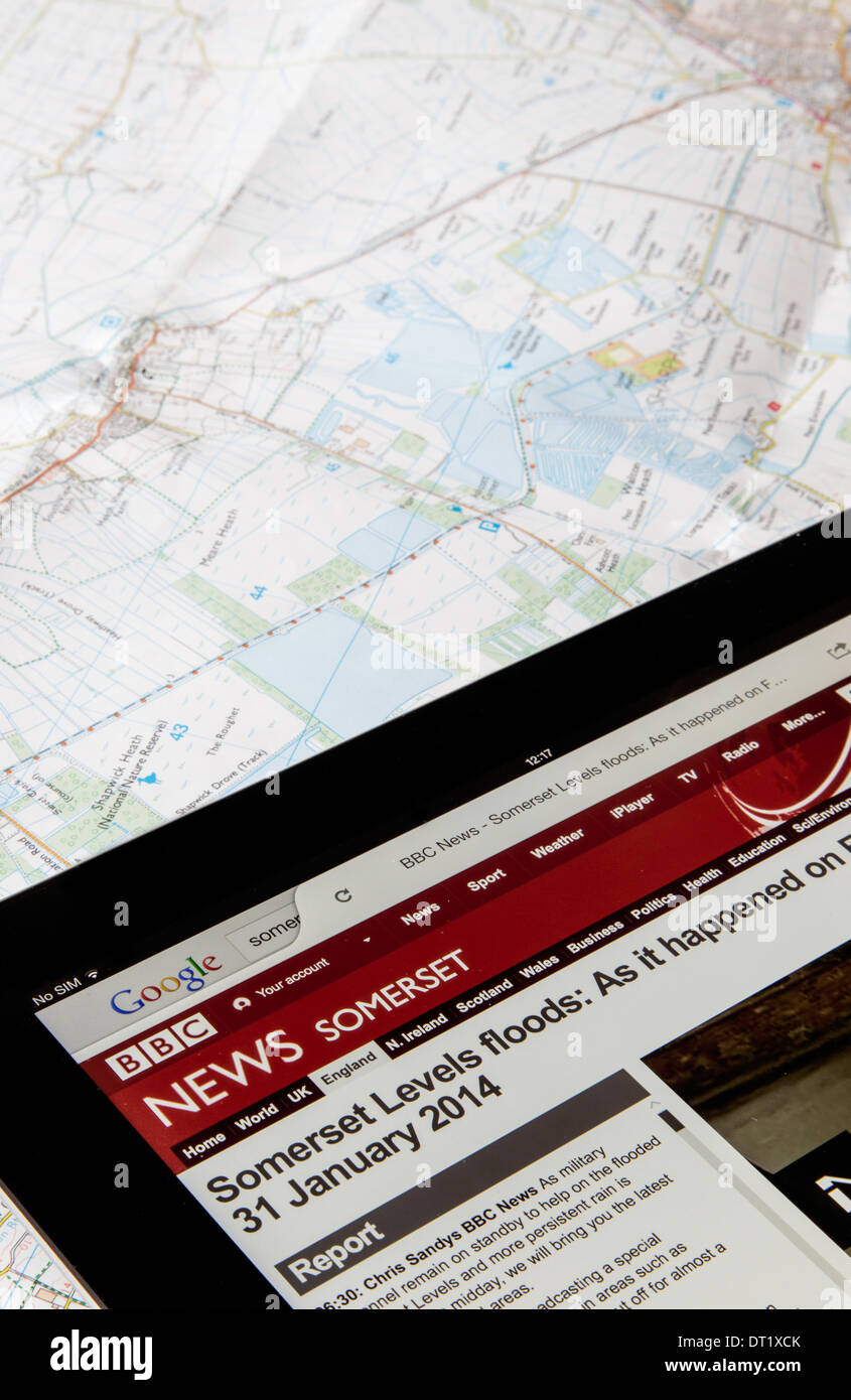 News feature of the flooding on the Somerset Levels on an i pad with o/s map of the area, England, UK - Stock Image
