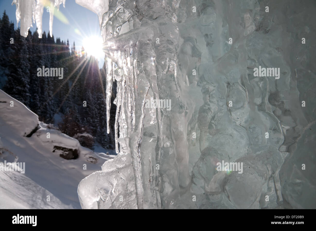 Icicles at the winter icefall and sun - Stock Image