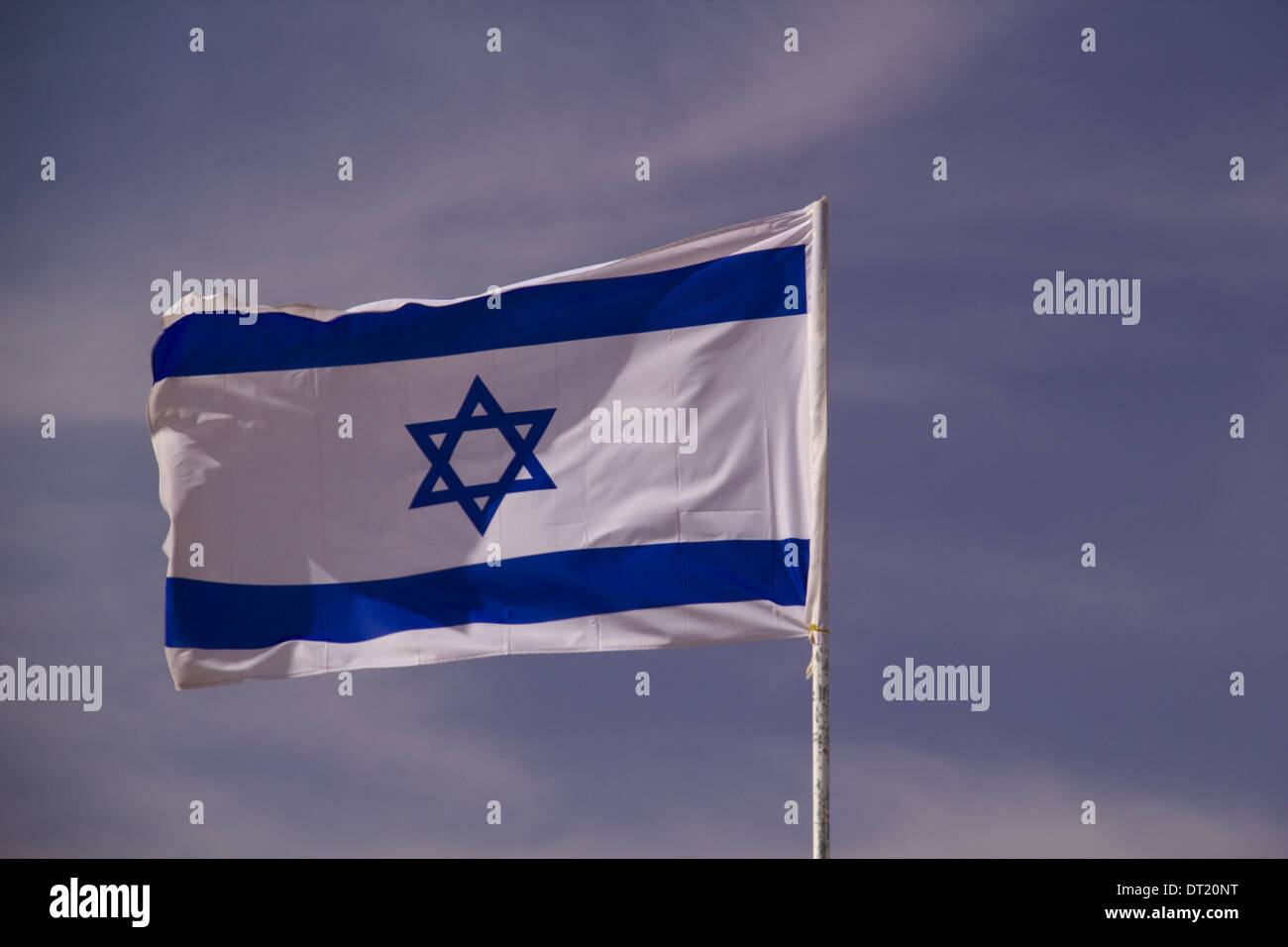 The blue and white national flag of Israel blowing in the wind. - Stock Image