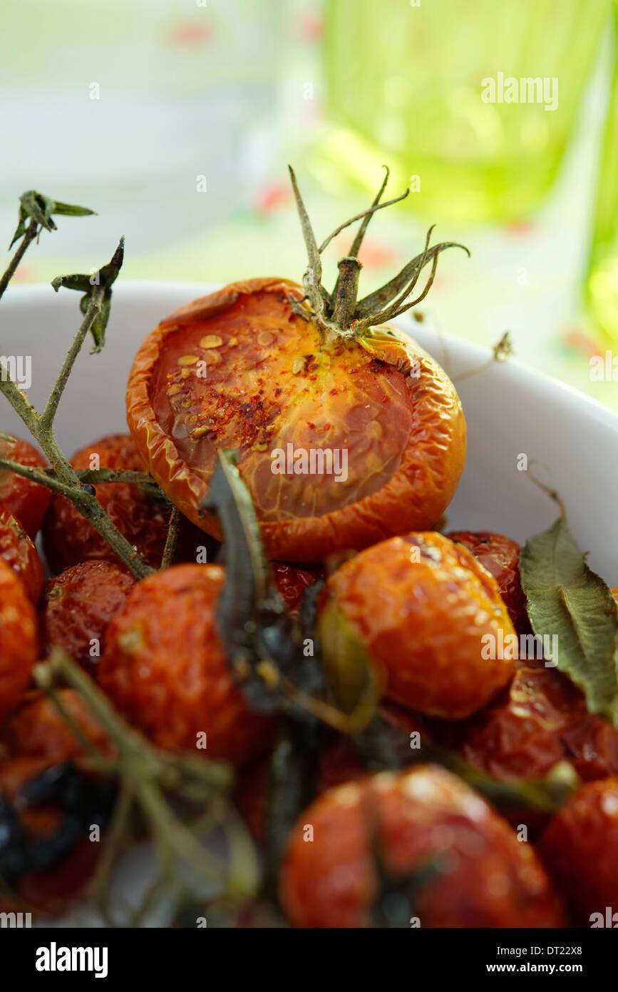 Tomatoes with lemon and raspberry vinegar - Stock Image