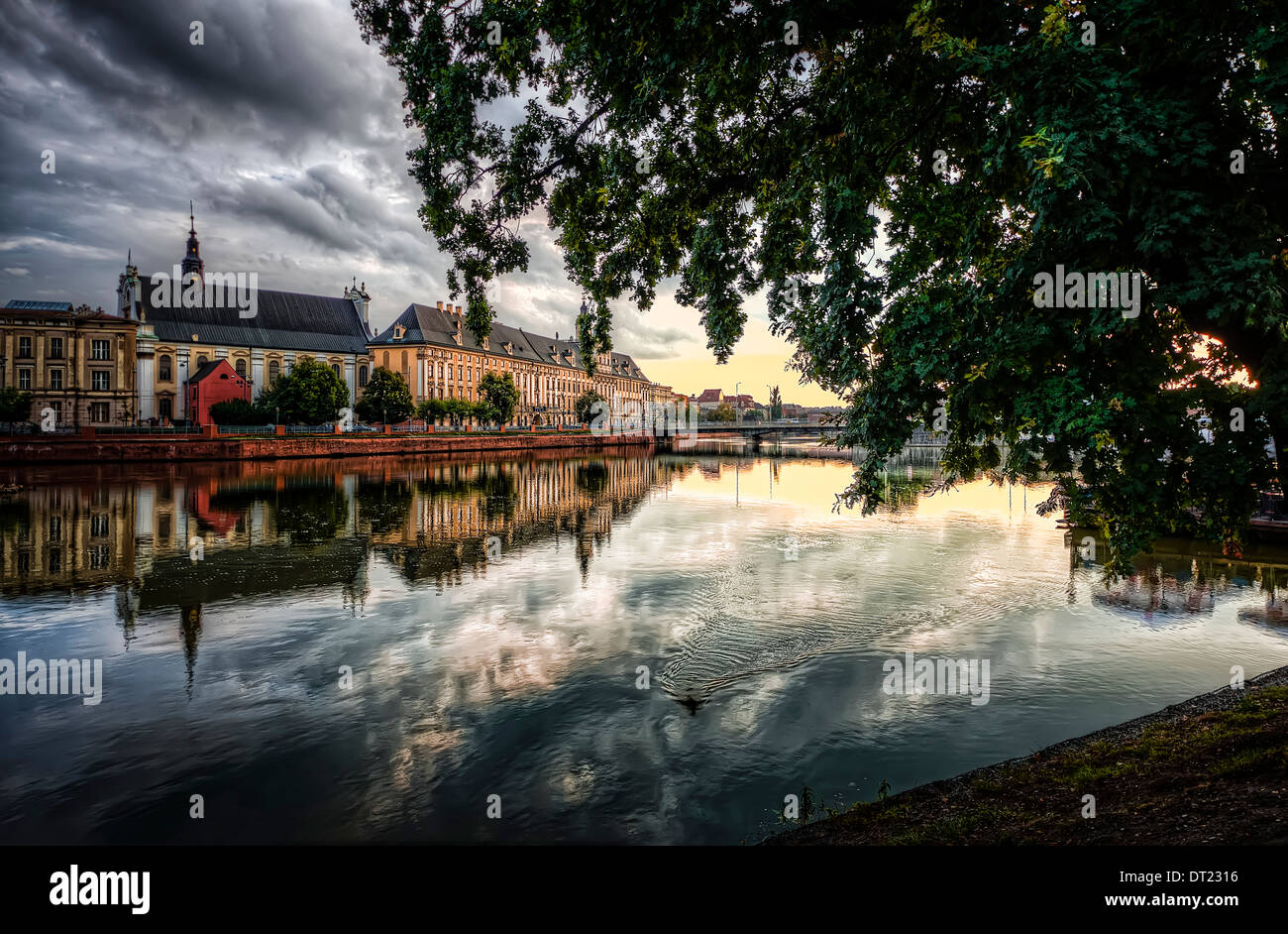Wroclaw, Poland, Sunset over the river Oder and the University building - Stock Image