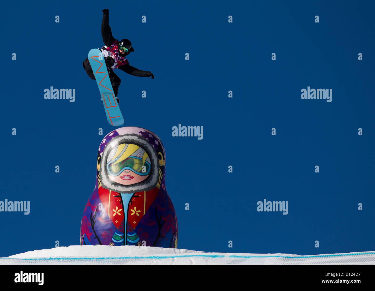 Sochi, Russia. 6th Feb, 2014. JAN SCHERRER of Switzerland comes off a rail and airs over an inflated matryoshka doll on the slopestyle course during Mens Slopestyle qualifying heats at Rosa Khutor Extreme Park. Credit:  U-T San Diego/ZUMAPRESS.com/Alamy Live News - Stock Image