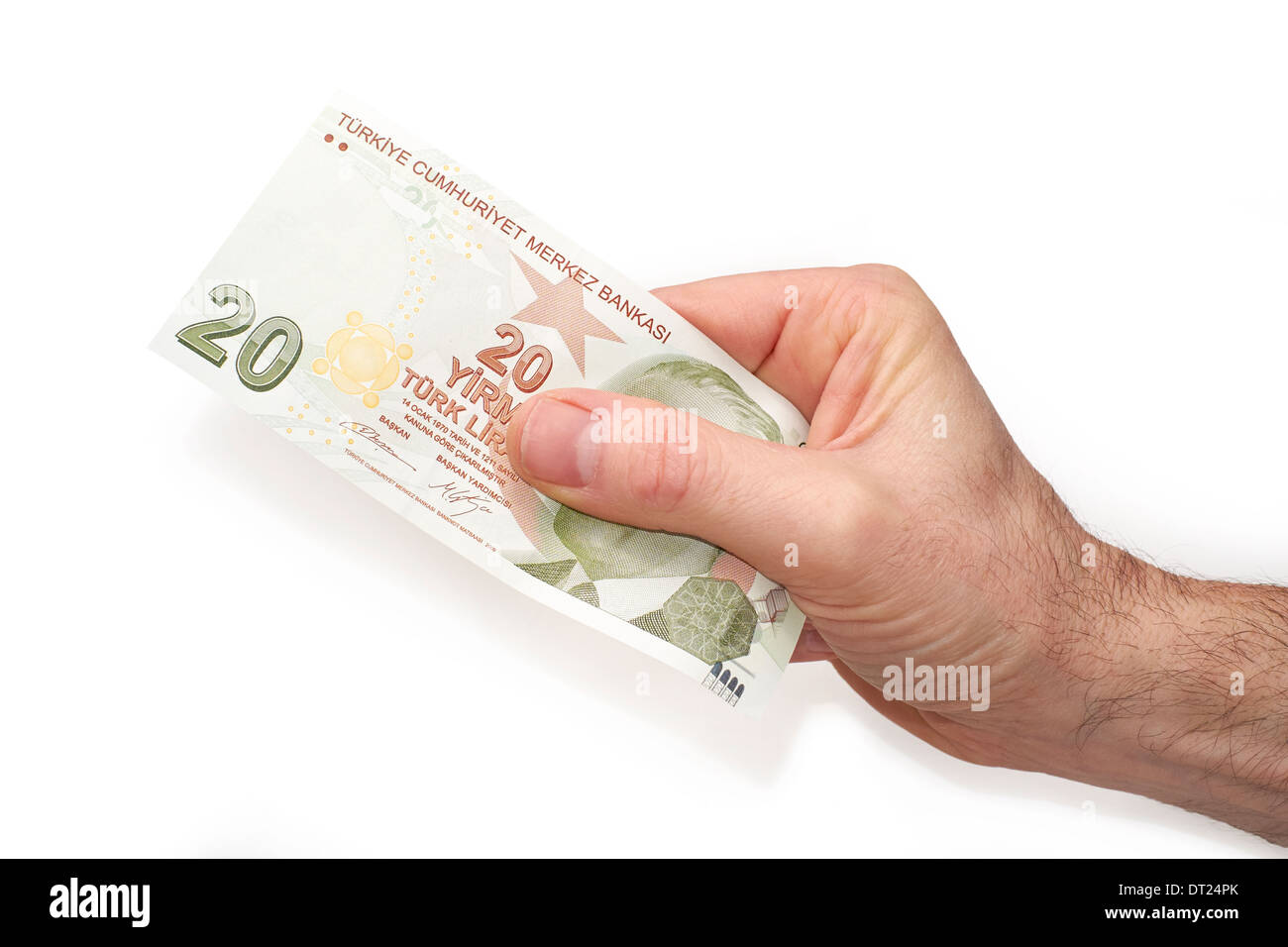 A hand holding a Turkish 20 Lira note, on a white background. Stock Photo