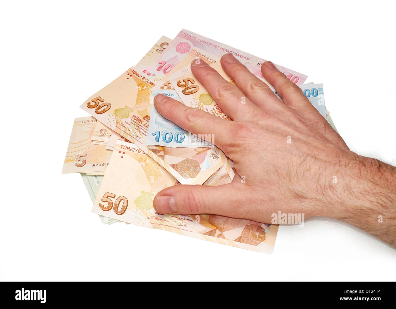A hand holding a mixture of Turkish Lira Currency, on a white background. Stock Photo