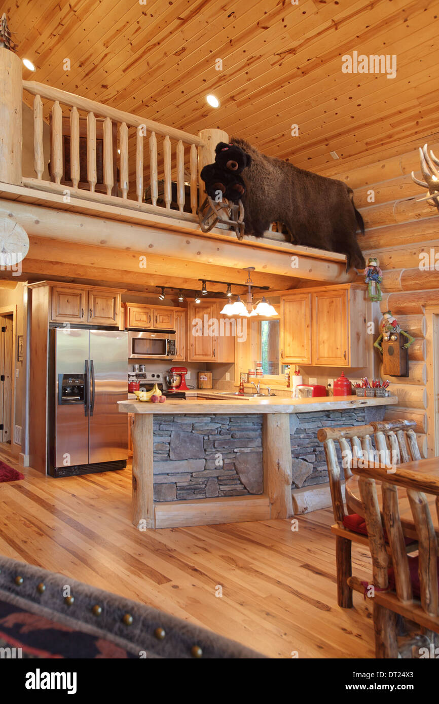 The kitchen in a modern log cabin Stock Photo: 66430619 - Alamy