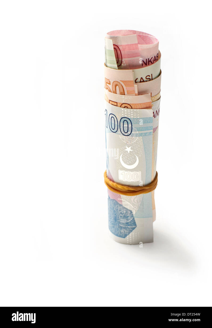 A roll of Turkish Lira Currency, on a white background. Stock Photo